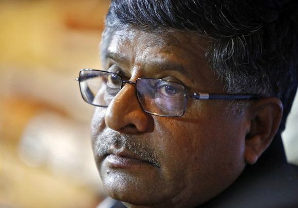Law Minister Ravi Shankar Prasad, pauses during a news conference in New Delhi June 17, 2014. REUTERS/Anindito Mukherjee