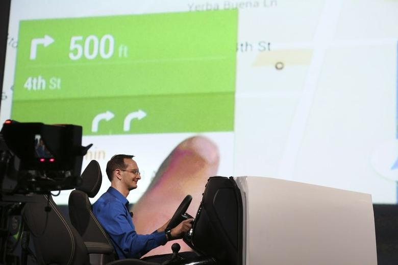 A Google employee demonstrates Android Auto onstage during a keynote address at the Google I/O developers conference in San Francisco June 25, 2014. REUTERS/Elijah Nouvelage