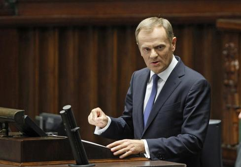 Polish PM Tusk wins confidence vote despite tapes scandal