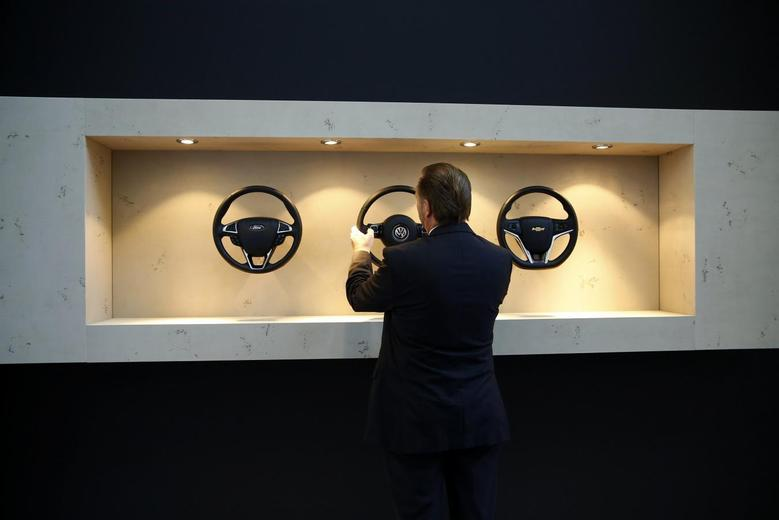 A visitor compares steering wheels at the Takata exhibition stand during a media preview day at the Frankfurt Motor Show (IAA), in this file picture taken September 10, 2013.   REUTERS/Kai Pfaffenbach/Files