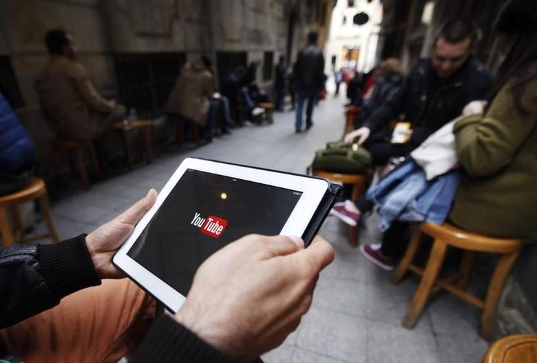 A man tries to get connected to the youtube web site with his tablet at a cafe in Istanbul March 27, 2014. REUTERS/Osman Orsal