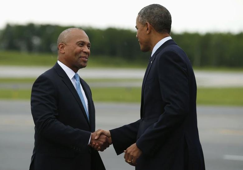 U.S. President Barack Obama shakes hands with Massachusetts Governor Deval Patrick upon his arrival in Worcester June 11, 2014. REUTERS/Kevin Lamarque