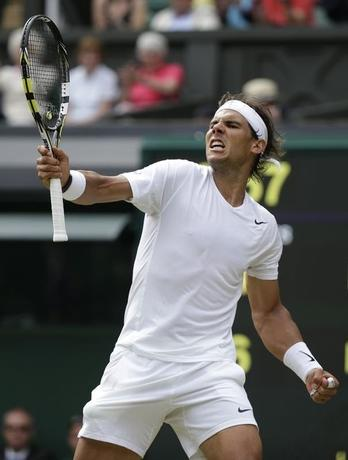 Rafael Nadal of Spain reacts after defeating Lukas Rosol of the Czech Republic in their men's singles tennis match at the Wimbledon Tennis Championships, in London June 26, 2014.REUTERS/Max Rossi
