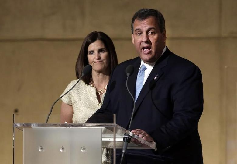 New Jersey Governor Chris Christie (R), accompanied by his wife Mary Pat Christie speaks at the dedication ceremony at the National September 11 Memorial Museum in New York, May 15, 2014.  REUTERS/Richard Drew