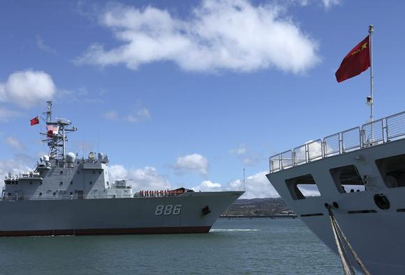 The Chinese People's Liberation Army (PLA) Navy replenishment ship Qiandaohu (866) (L) sails past the PLA Navy hospital ship, Peace Ark, as it docks at the Joint Base Pearl Harbor Hickam to participate in the multi-national military exercise RIMPAC 2014, in Honolulu, Hawaii, June 24, 2014. RIMPAC is the world's largest biennial naval exercise between the U.S. and Pacific Rim nations, with 23 countries participating this year, including China who will be joining it for the first time. REUTERS/Hugh Gentry