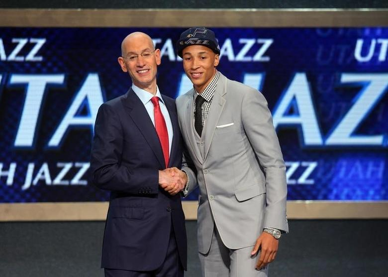 Jun 26, 2014; Brooklyn, NY, USA; Dante Exum (Australia) shakes hands with NBA commissioner Adam Silver after being selected as the number five overall pick to the Utah Jazz in the 2014 NBA Draft at the Barclays Center. Brad Penner-USA TODAY Sports