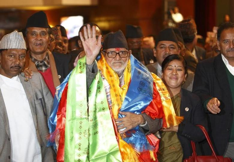 Newly elected Nepalese Prime Minister Sushil Koirala waves towards media personnel as he walks out from the Parliament after being elected Prime Minister in Kathmandu February 10, 2014. REUTERS/Navesh Chitrakar