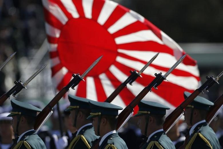 Japan Self-Defence Forces' (SDF) troops march during the annual SDF troop review ceremony at Asaka Base in Asaka, near Tokyo October 27, 2013.  REUTERS/Issei Kato