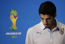 Uruguay's national soccer team player Luis Suarez arrives at a news conference prior a training session at the Dunas Arena soccer stadium in Natal, June 23, 2014.  REUTERS/Carlos Barria