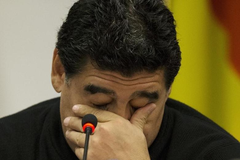 Former Argentine soccer player Diego Maradona reacts during a news conference at the European Parliament office in Rome February 14, 2014. REUTERS/Giampiero Sposito