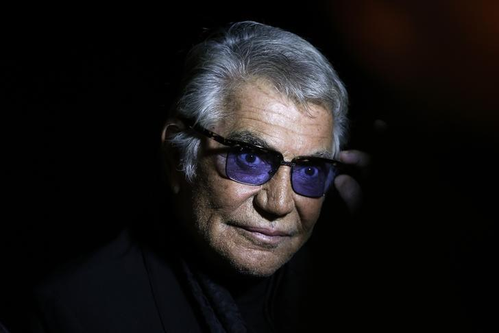 Italian designer Roberto Cavalli poses before the start of his Spring/Summer 2014 collection during Milan Fashion Week September 21, 2013. REUTERS/Max Rossi