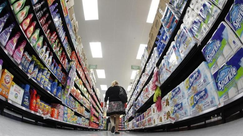 A shopper walks down an aisle in a newly opened Walmart Neighborhood Market in Chicago in this September 21, 2011 file photo.   REUTERS/Jim Young/Files