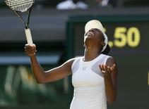 Venus Williams of the U.S. reacts during her women's singles tennis match against Petra Kvitova of Czech Republic on Centre Court at the Wimbledon Tennis Championships in London June 27, 2014. REUTERS/Stefan Wermuth