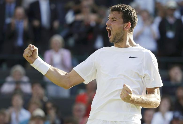 Grigor Dimitrov of Bulgaria celebrates after defeating Alexandr Dolgopolov of Ukraine in their men's singles tennis match on Court 1 at the Wimbledon Tennis Championships in London June 27, 2014.       REUTERS/Max Rossi