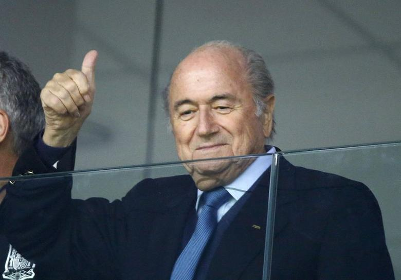 FIFA President Sepp Blatter gives a thumbs-up sign before 2014 World Cup Group E soccer match between Ecuador and Honduras at the Baixada arena in Curitiba June 20, 2014.  REUTERS/Stefano Rellandini