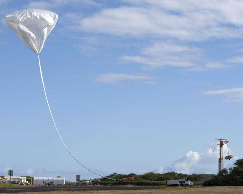 A high altitude balloon is released to launch a saucer-shaped test vehicle, which holds equipment for landing large payloads on Mars, at the U.S. Navy's Pacific Missile Range Facility in Kauai, Hawaii June 28, 2014.   REUTERS/Marco Garcia