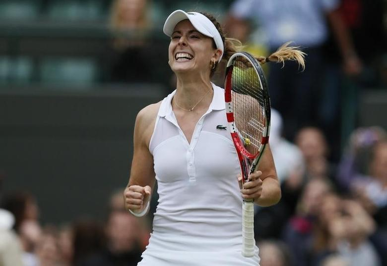 Alize Cornet of France reacts after defeating Serena Williams of the U.S. in their women's singles tennis match at the Wimbledon Tennis Championships, in London June 28, 2014.     REUTERS/Stefan Wermuth