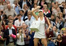 Jun 28, 2014; London, United Kingdom; Maria Sharapova (RUS) waves to the crowd after her match against Alison Riske (USA) on day six of the 2014 Wimbledon Championships at the All England Lawn and Tennis Club. Susan Mullane-USA TODAY Sports