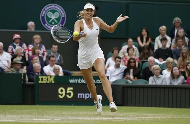 Maria Sharapova of Russia hits a return to Alison Riske of the U.S. during their women's singles tennis match at the Wimbledon Tennis Championships, in London June 28, 2014.              REUTERS/Suzanne Plunkett