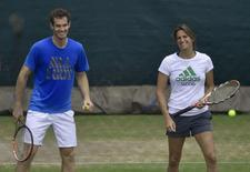 Andy Murray of Britain (L) shares a moment with his coach Amelie Mauresmo as he practices at the Wimbledon Tennis Championships in London June 29, 2014. REUTERS/Toby Melville