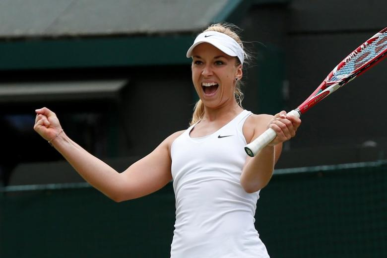 Sabine Lisicki of Germany reacts after defeating Ana Ivanovic of Serbia in their women's singles tennis match at the Wimbledon Tennis Championships, in London June 30, 2014.REUTERS/Suzanne Plunkett