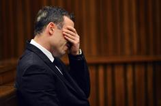South African Olympic and Paralympic athlete Oscar Pistorius reacts in the dock during his murder trial in the North Gauteng High Court in Pretoria June 30, 2014. REUTERS/Phill Magakoe/Pool