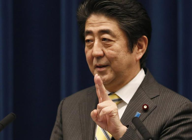 Japan's Prime Minister Shinzo Abe gestures during a news conference at his official residence in Tokyo June 24, 2014.  REUTERS/Yuya Shino