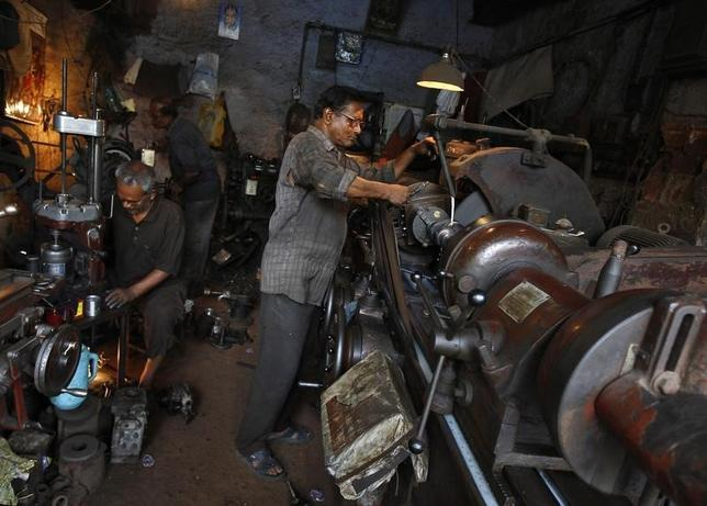 Men work inside a car spare parts manufacturing workshop in Kolkata May 2, 2014. REUTERS/Rupak De Chowdhuri/Files