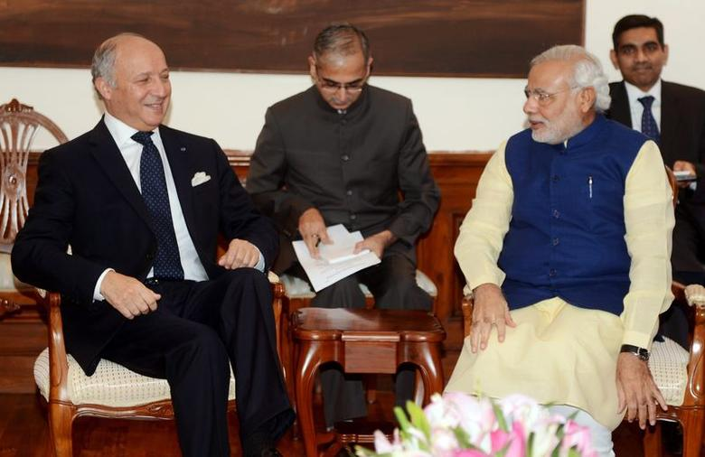 India's Prime Minister Narendra Modi speaks with French Foreign Minister Laurent Fabius (L) during a meeting at his residence in New Delhi July 1, 2014. REUTERS/Raveendran/Pool