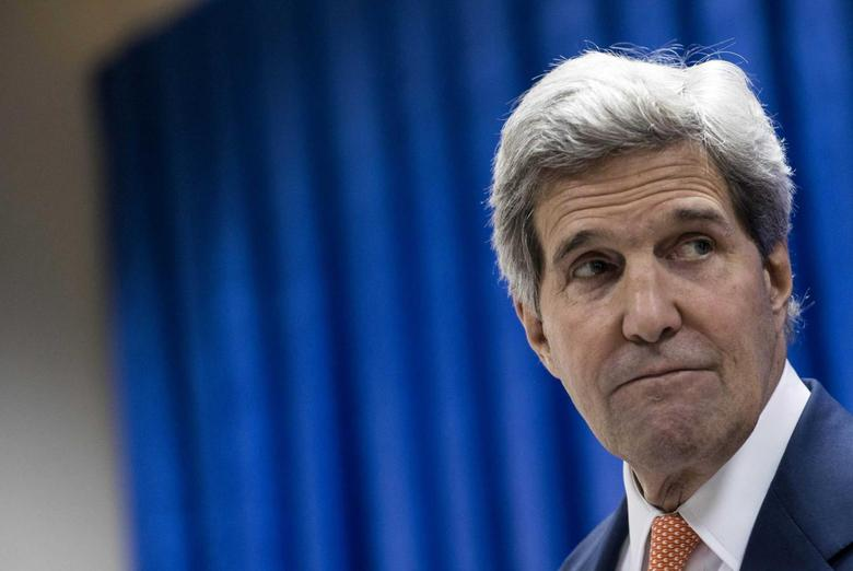 U.S. Secretary of State John Kerry pauses as he speaks during a news conference at the U.S. embassy in the International Zone in Baghdad June 23, 2014.  REUTERS/Brendan Smialowski/Pool