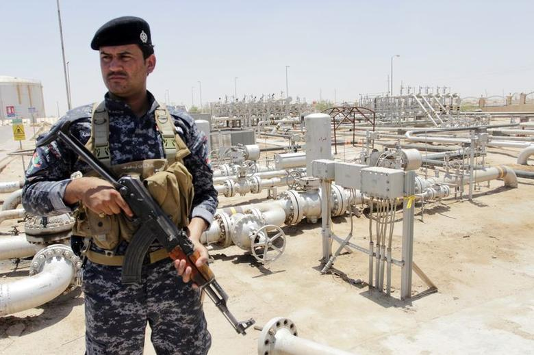 A member from the oil police force stands guard at Zubair oilfield in Basra, southeast of Baghdad June 18, 2014.    REUTERS/ Essam Al-Sudani