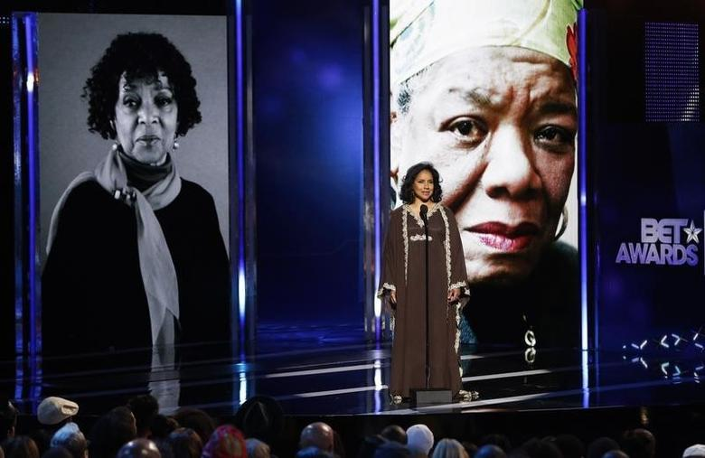 Phylicia Rashad introduces the ''In Memoriam'' segment, paying tribute to actress and activist Ruby Dee (L) and author Maya Angelou, during the 2014 BET Awards in Los Angeles, California June 29, 2014.  REUTERS/Mario Anzuoni