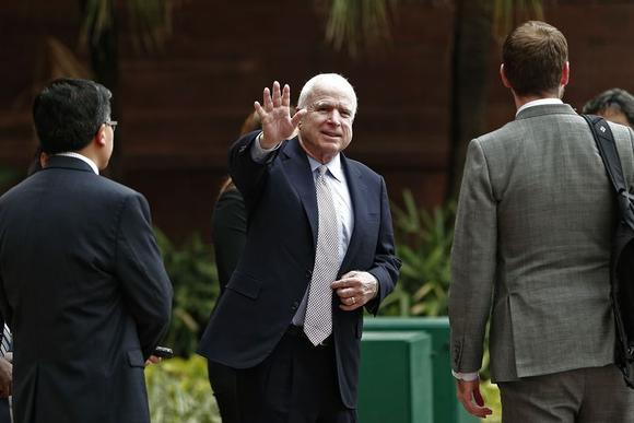 U.S. Senator John McCain waves to members of the media after his meeting with Foreign Minister Sushma Swaraj in New Delhi July 2, 2014.  REUTERS/Adnan Abidi