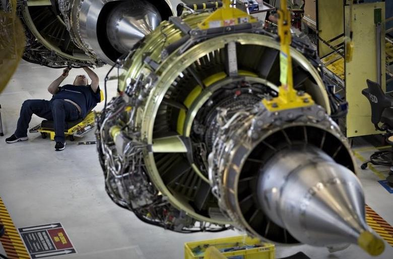 A worker builds an engine for the Boeing 737-900 at their assembly operations in Renton, Washington, October 18, 2012. REUTERS/Andy Clark
