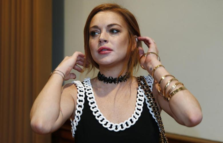 Actress Lindsay Lohan arrives for the presentation of the Moschino collection during its London Collections: Men show in London June 16, 2014. REUTERS/Suzanne Plunkett
