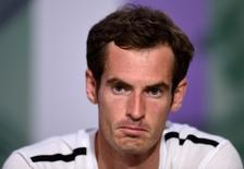 Andy Murray of Britain attends a news conference after being defeated by Grigor Dimitrov of Bulgaria in their men's singles quarter-final tennis match at the Wimbledon Tennis Championships, in London July 2, 2014.  REUTERS/Billie Weiss/AELTC/Pool