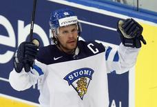 Finland's Olli Jokinen celebrates his goal against Switzerland during the second period of their men's ice hockey World Championship Group B game against Finland at Minsk Arena in Minsk May 16, 2014. REUTERS/Alexander Demianchuk