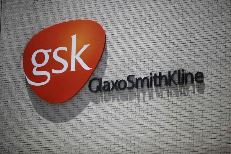 The logo of GlaxoSmithKline (GSK) is seen on its office building in Shanghai in this July 12, 2013 file photo.  REUTERS/Aly Song/Files