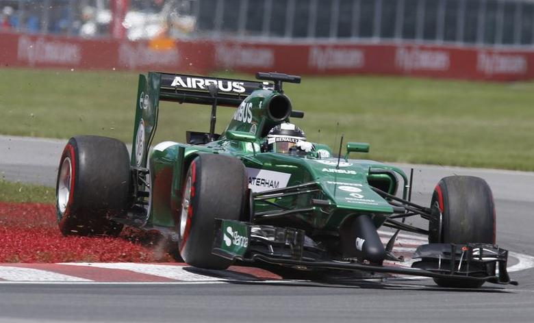 Caterham Formula One driver Kamui Kobayashi of Japan goes off the track during the qualifying session of the Canadian F1 Grand Prix at the Circuit Gilles Villeneuve in Montreal June 7, 2014.   REUTERS/Chris Wattie