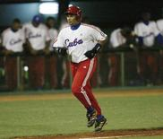 "Cuban baseball player Frederich ""Freddy"" Cepeda scores a home run against South Korea, in the fourth inning of their elimination game at the 35th Baseball World Championships in Havana in this October 14, 2003 file photograph. REUTERS/Claudia Daut/Files"