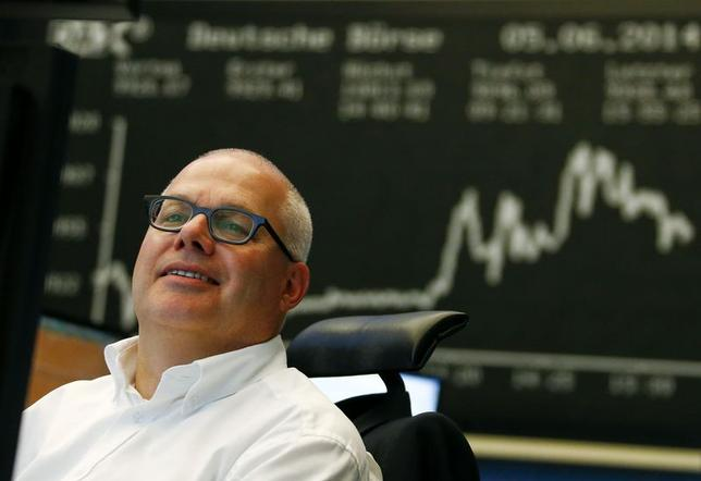 A trader works at Frankfurt stock exchange June 5, 2014. REUTERS/Ralph Orlowski/Files