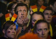People watch Germany play against Algeria during their 2014 World Cup round of 16 game, at the Fanmeile public viewing arena in Berlin June 30, 2014. REUTERS/Thomas Peter