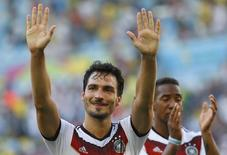 Germany's Mats Hummels gestures in front of teammate Jerome Boateng as they celebrate their win over France after their 2014 World Cup quarter-finals at the Maracana stadium in Rio de Janeiro July 4, 2014. REUTERS/Kai Pfaffenbach
