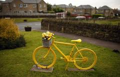 A yellow bicycle is pictured on the route of the Tour de France in the village of Barkisland, northern England June 17, 2014. REUTERS/Phil Noble