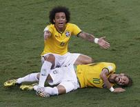 Brazil's Marcelo gestures over his injured teammate Neymar, who was fouled by Colombia's Camilo Zuniga (not pictured) during their 2014 World Cup quarter-finals at the Castelao arena in Fortaleza July 4, 2014. REUTERS/Leonhard Foeger