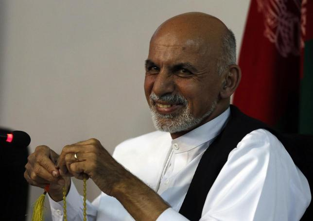 Afghan presidential candidate Ashraf Ghani Ahmadzai smiles during a news conference in Kabul June 26, 2014. REUTERS/Omar Sobhani
