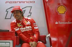 Ferrari Formula One driver Fernando Alonso of Spain looks on during final practice ahead of the British Grand Prix at the Silverstone Race Circuit, central England, July 5, 2014. REUTERS/Paul Hackett