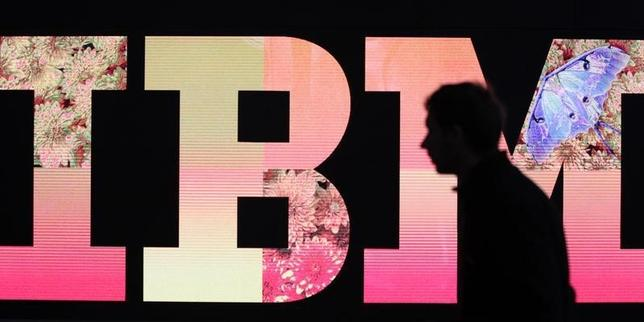 A man passes by an illuminated IBM logo at the CeBIT computer fair in Hanover February 27, 2011. REUTERS/Tobias Schwarz