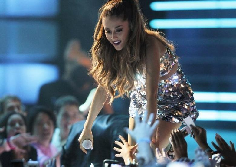 Ariana Grande touches fans as she performs during the MuchMusic Video Awards (MMVA) in Toronto, June 15, 2014. REUTERS/Fred Thornhill
