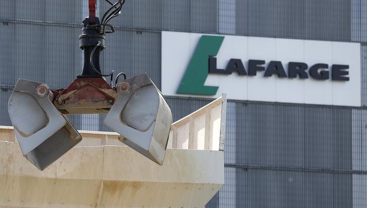 A logo is seen at a Lafarge concrete production plant in Pantin, outside Paris, April 7, 2014.   REUTERS/Christian Hartmann